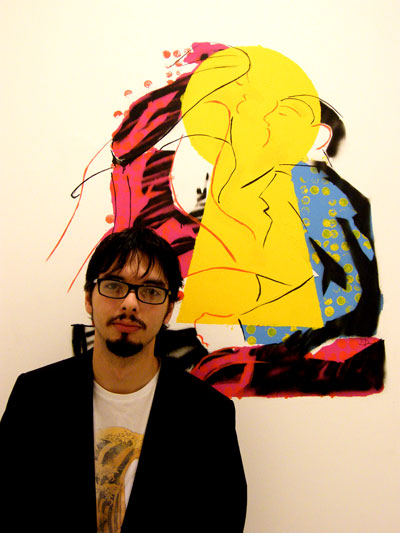 Artist Dave Poland with one of his paintings