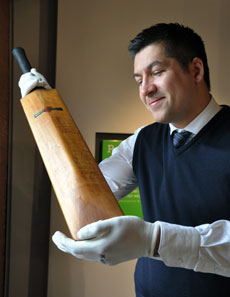 Museum director Dr Richard Benjamin with his father's signed bat