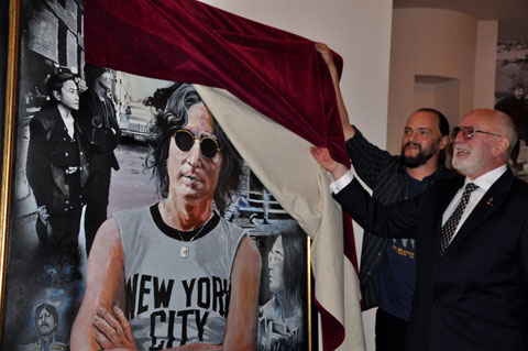 Artist Sven Reimers and Joe Flannery unveil the painting