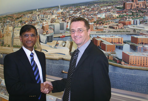 Professor Gerald Pillay, Liverpool Hope University's Vice-Chancellor and David Fleming have signed a memorandum of understanding which will see the institutions working closer together.