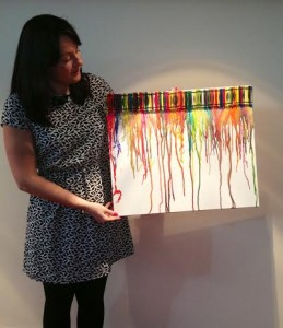 Hannah Longworth, Curator of The World of Glass, displays a colourful entry for the Youth Open competition.