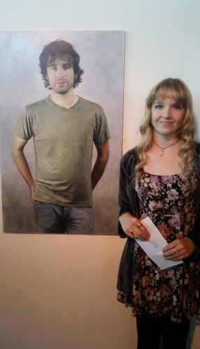 Laura-with-her-prize-winning-portrait.