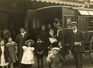 Children and teachers from Orwell Road Special School, Kirkdale get ready to set off for an enjoyable day trip wearing their best clothes, around 1910.