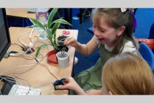 Students from St.Mary's and St.Thomas primary school in St.Helens trigger a robot arm with a plant sensor.