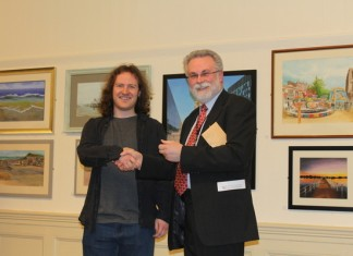 Felix Leyland (left) receives his award from Colin Simpson