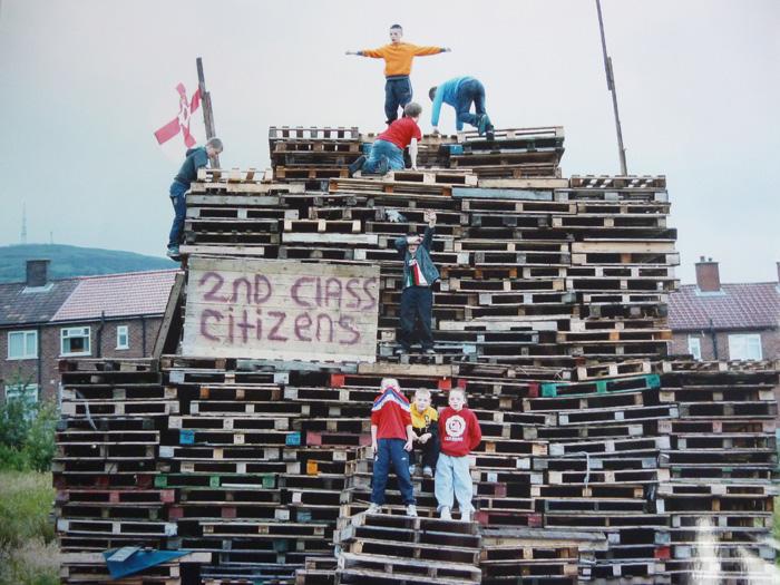Her Majesty's loyal subjects. Loyalist bonfire, Second class citizens, Glenbryn Park, Ardoyne, North Belfast, 2012. Tony Crowley